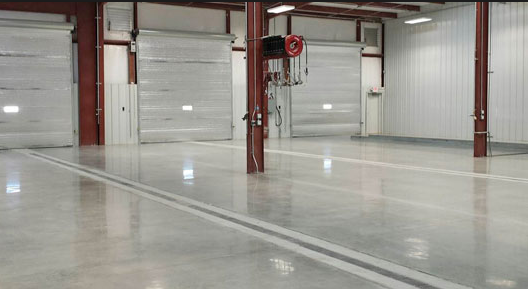 ​Commercial flooring in bright large garage.